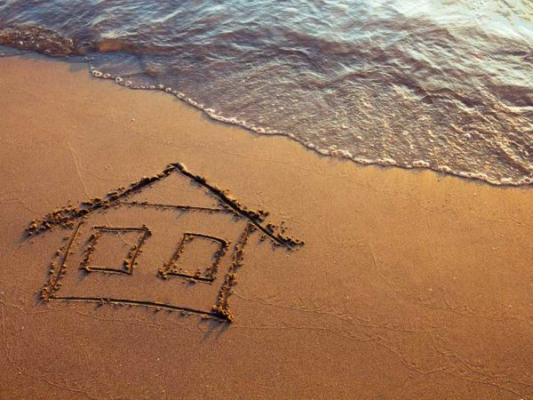 House Drawn in Sand by Ocean